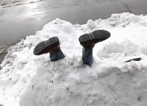 Suicide by snow? Dibs on a parking spot? The pair of legs sticking out of a snowbank at Oak Park and Stanley in Berwyn were placed outside George's Tavern as a joke and have amused passersby for days.