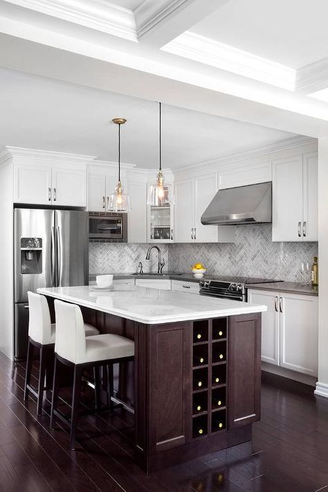 A Stunning Dark Stained Kitchen Island Fitted With A Built In Wine Rack And A White Quartz Countertop Seats Two W Kitchen Design Built In Wine Rack Countertops