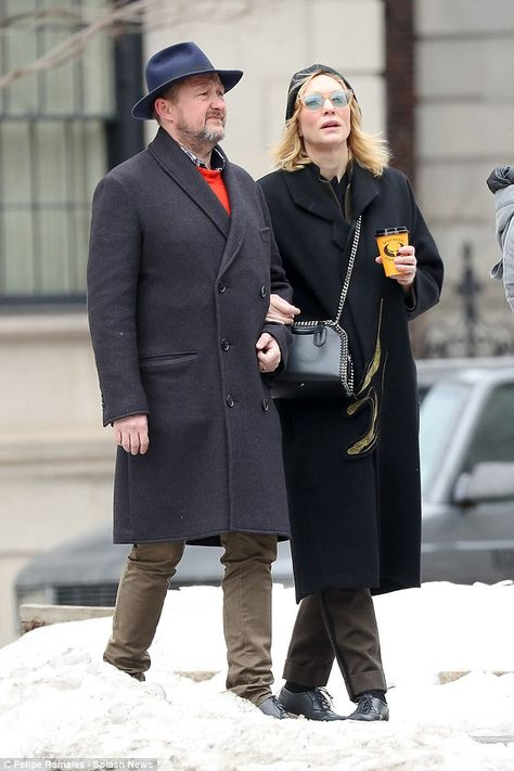 Stylish: The 47-year-old and her husband - who adapted the play she starred in - both looked stylish in trench coats and lace-up leather shoes, with Cate adding a touch of flair with horn-rimmed glasses