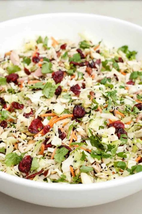Asian Chicken Cranberry Salad: BEST Asian Chicken Cranberry Salad, a main dish or side dish that is popular at any potluck or holiday party! #chickenrecipes #chickenbreastrecipes #chickensalad #asianchickensalad #holidayrecipe #potllucksalad #potluckrecipes #asiansalad #reluctantentertainer #easymeals