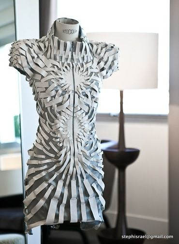 Architecture Vs Human Anatomy - YIQING YIN I like this piece for the repetition create a central focal point giving shape and curves to the dress.