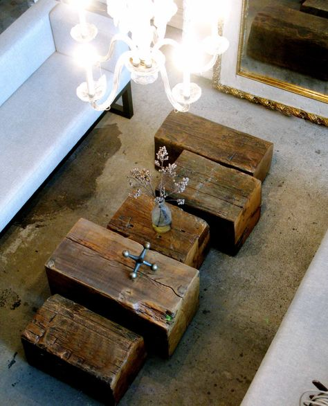 old blocks of wood are now coffee tables