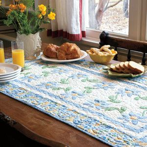 Floral applique quilted table runner.