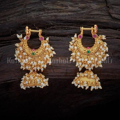 Designer antique jhumka earrings studded with synthetic ruby green stones, plated with gold polish and made of copper alloy Source by KushalsFashionJewellery
