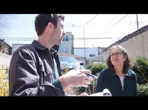 The Center for Neighborhood Technology Wetrofit® team visits a rental property owned by Margaret O'Dell to assess the building's flooding problem and offer potential solutions.