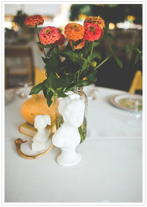 love these little vintage busts with a simple arrangement.