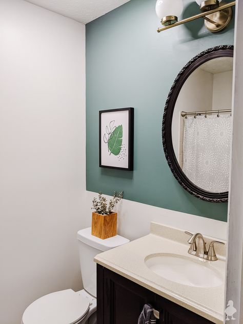 Guest bathroom with a perfect white for windowless rooms with no natural light and nature-inspired green accent wall. So refreshing for guests! Uses colors from Clark+Kensington 2020 Color Trends. #ad #AcePartner #thehelpfulplace #clarkandkensington #mylocalAce