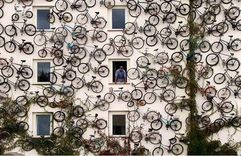 is that wall made out of bicycles?