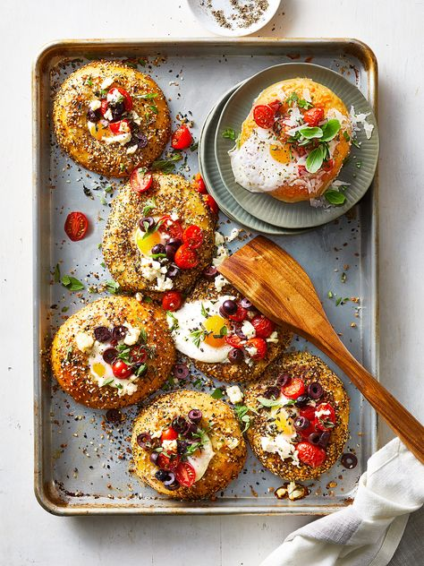 For an Italian spin, start with Asiago cheese bagels and use roasted red peppers instead of olives, basil and oregano for the herbs, and shredded Parmesan for the cheese. #breakfast #brunchrecipe #egginthehole #bagel #bhg