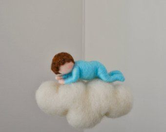 This is a Waldorf inspired piece made of wool by the needle-felting technique. Its been created to provide a peaceful and harmonious image that communicates with the soul through its colors, textures, forms and energy. Dimensions: 6 in length, 6 height Doll: 3.5in Boy SHIPPING: Since