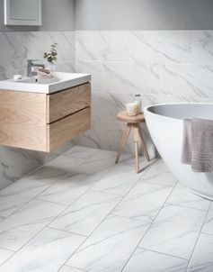 Wickes Calacatta Matt White Glazed Marble Effect Porcelain Tile 600 X 300mm Wickes Co Uk Bathroom Wall Tile Ceramic Tile Bathrooms Bathroom Floor Tiles