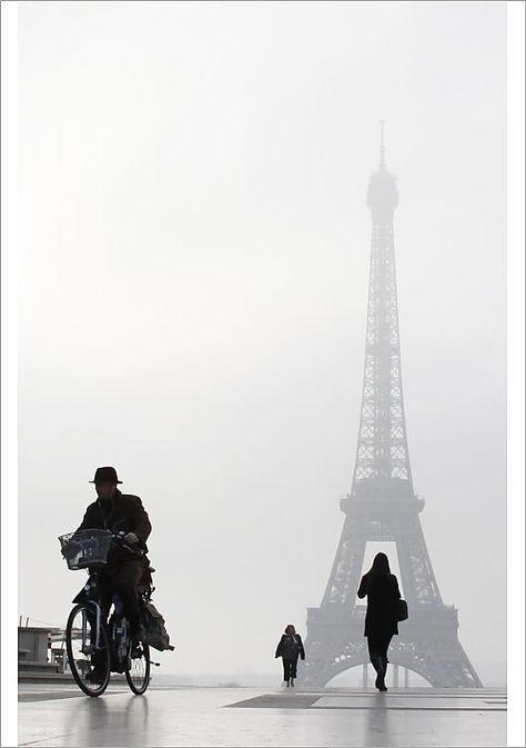 A1 Poster. Man Rides a Bicycle Esplanade Du Trocadero