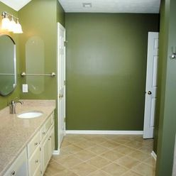 Bathroom Remodel With Tile Tube Surround And HD Vinyl Floor By - Hatchett bathroom remodel