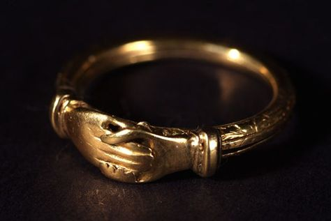 Rings such as this one, with a clasped hand design, are known as fede rings. The design has been in use on love rings throughout Europe since Roman times.