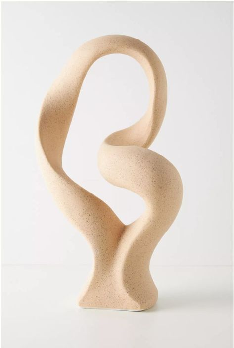 Crafted from matte stoneware in an organic shape, this piece lends a modern twist to your decor. From Anthropologie
