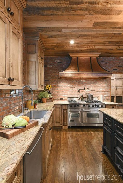 A solid bronze range hood makes a distinct statement above the Viking range in this rustic kitchen. Log Home Kitchens, Custom Kitchens, Open Kitchens, Rustic Kitchen Design, Country Kitchen, Kitchen Redo, Kitchen Remodel, Kitchen Island, Kitchen Ideas