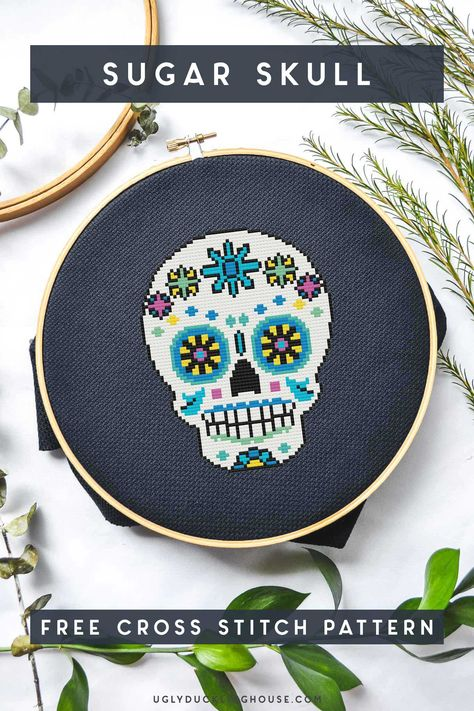 Grab this super-simple but oh-so-colorful FREE cross stitch pattern that's designed to look like a sugar skull! Sugar skull cross stitch pattern #diadelosmuertos #dayofthedead #halloween #skull #colorful #crossstitch #xstitch