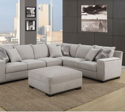 Chaise Sofa The Mathis Sectional and Ottoman Set features cozy chic styling exquisite nail head accents and deep luxurious seating The set includes matchin u