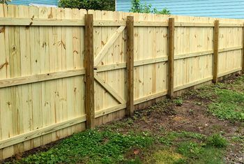 How To Fill In A Gap Under Fencing Home Guides Sf Gate Fence Contractor Fence Wood Fence