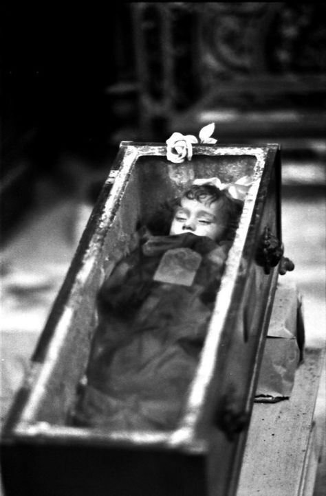 catacombs # 3…. (by manuel cristaldi)  This photo of Rosalia Lombardo was taken in 1984. Why is that interesting? She was the last person buried in the catacombs of the Capuchin Monastery 64 years before this photo was taken, in 1920.