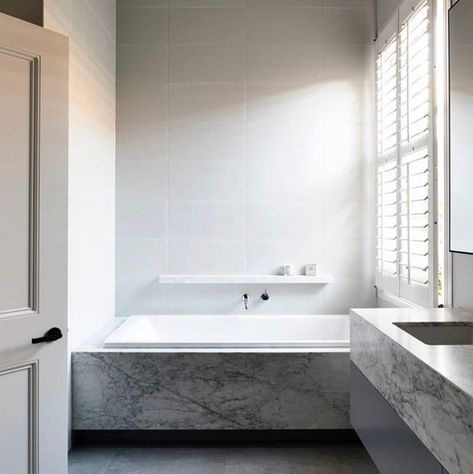 I love the combination of marble and white tiles in this stunning bathroom by @austin_design_associates  Are you considering incorporating marble into your next renovation project?  Check out all the pros and Cons...    ������ @derek_swalwell   . . . . . . . #interiordesign #design #interiors #homedecor #style #decor #architecture #home #bathroom #instagood #naturalstone #inspiration #marble #luxuryhomes #tiles #stone #designer #homedesign #marblebathroom
