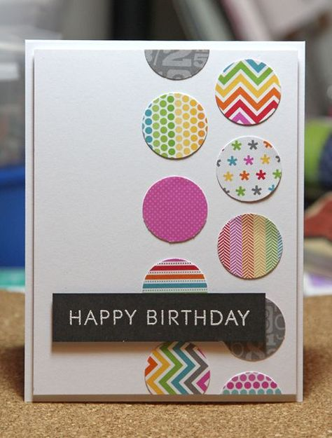 handmade birthday card ,.. graphic look ... two columns of punched circles ... great use of scraps ... white heat embossed sentiment on black makes it stand out from brightly colored circles ...