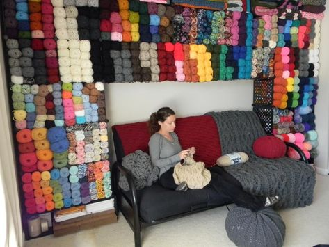 This is great.  She took cubes that she bought at WalMart and her husband attached them to the wall for yarn storage.  My someday craft room.
