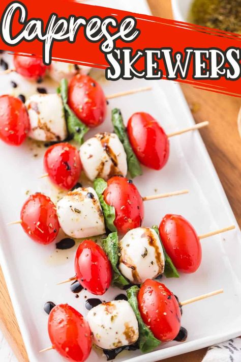 Caprese Skewers are a super easy, Italian-inspired appetizer made with tomato, mozzarella, and basil, drizzled with a homemade balsamic glaze and seasoned olive oil mix.