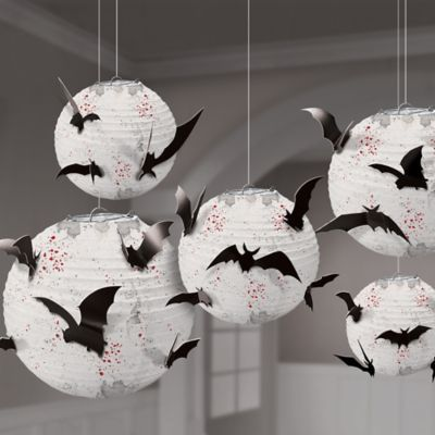 Add a spooky element to your Halloween party decor with the Dark Manor Bat Paper Lanterns! These Halloween paper lanterns are white with a red and black splatter design and include black cardstock bat cutouts to attach to the paper lanterns. Halloween Classroom Decorations, Halloween Home Decor, Halloween Crafts, Halloween Decorating Ideas, Diy Halloween Decorations For Outside, Halloween Window Display, Paper Party Decorations, Halloween Lanterns, House Decorations