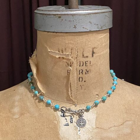 """6mm Kingman Turquoise beads, sterling silver wire, hinged hook clasp and small Fortune Favors the Bold Logo medal. Medal measures 1/2"""", necklace is 16"""" around. Custom sizing upon request. Great simple everyday piece. Turquoise balances and aligns all the chakras, stabilizing mood swings and instilling inner calm. It is excellent for depression and exhaustion, it also has the power to prevent panic attacks. Turquoise promotes self-realization and assists creative problem solving. The turquoise I"""