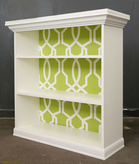 Spruce up your bookshelf with this DIY wallpapered look