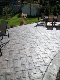 patio stamped concrete patio with tables and chairs gray color