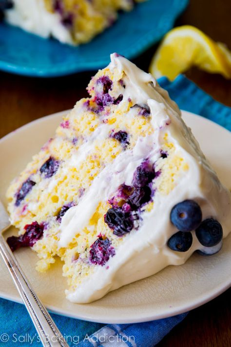Sunshine-sweet lemon layer cake dotted with juicy blueberries and topped with lush cream cheese frosting | sallysbakingaddiction.com | #berries #dessert_recipes