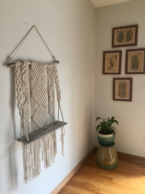 Hanging macrame shelf made with 100% cotton macrame cord, drift wood, pallet wood, and metal screw eye to hang from. 💗  ✨Perfect for your living room, bedroom, nursery, laundry room, the possibilities are endless! ✨ Also a perfect gift idea for a housewarming, Mother's Day, babyshower, birthdays! Or