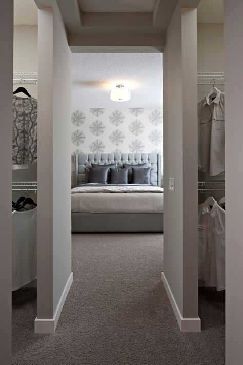 His and her closet with amazing wallpaper. Gray and white colors.