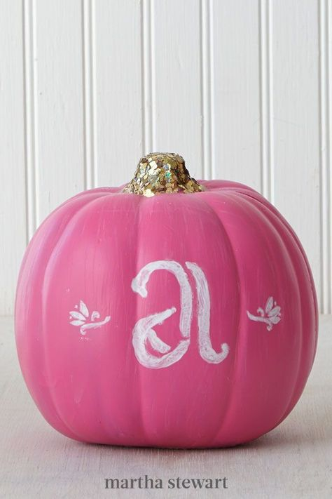 Channel your high school varsity days with this pink monogrammed design. To paint this pumpkin, cover it entirely in a color of your choice. Let dry, then apply an self-adhesive alphabet stencil to the front, paint within the lines, and slowly peel off. Top the stem with a generous sprinkling of glitter. #marthastewart #pumpkins #diypumpkins #falldecor #halloween