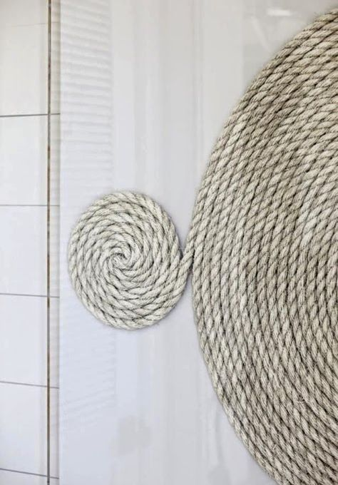 Idea for coiled rope wall art from a Beach House on Sullivan Island featured on Completely Coastal here: http://www.completely-coastal.com/2014/07/beach-house-sullivan-island.html