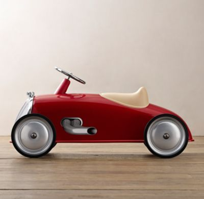 RH Baby & Child's Roadster Scoot - Red:Even the youngest drivers can power our scoot, which is designed without pedals for easy mobility. Its streamlined silhouette was inspired by vintage European race cars. The sturdy seat and silver-walled rubber tires promise a smooth ride through the backyard and beyond.