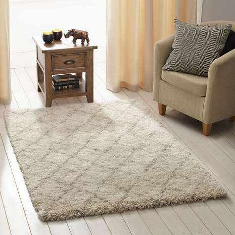 Crafted from durable material with a shaggy pile, this berber rug is