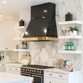 Polished Brass Trim On Black Kitchen Hood White Herringbone Tile Backsplash White Herringbone Tile White Marble Countertops
