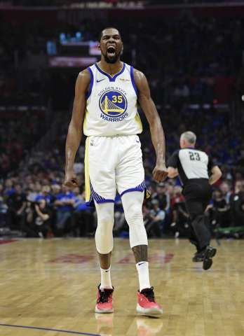 c5bfd56246e5 Golden State Warriors forward Kevin Durant celebrates after scoring during  the first half in Game 3