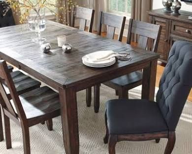 Trudell Dining Room Table By Ashley Homestore Dark Brown Round Dining Room Dining Table In Kitchen Dining Room Sets