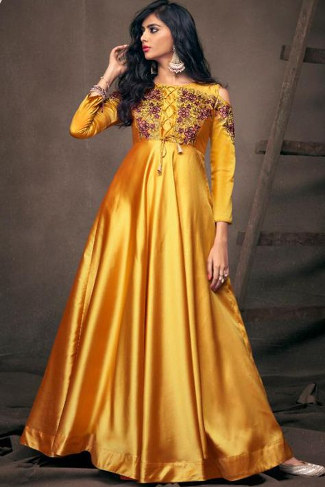 An ideal pick to garner complements for your ravishing ethnic look is this mustard yellow satin anarkali suit which will add oodles of charm to your special ethnic look. This round neck and full sleeve garment elaborated using resham work. Along with lycra churidar in mustard yellow color with mustard yellow chiffon dupatta. Churidar has plain work. Dupatta designed using plain work. This anarkali suit can be customised up to size maximum size available in inches 58, Slight color variation may o