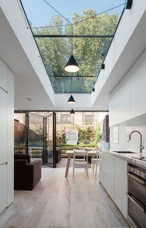 Ceiling windows bring the outdoors inside to give the kitchen a spacious appeal [From: Bolton Chalklin Architects]