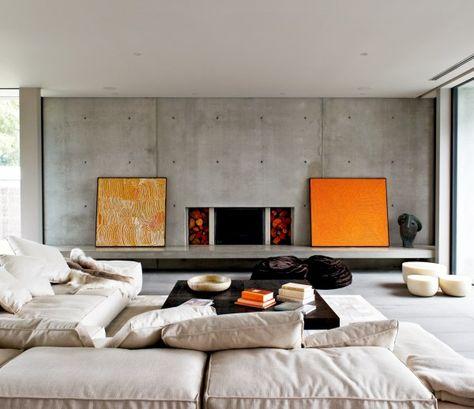 minimalistische kunst wohnzimmer sichtbeton wand orange gemälde
