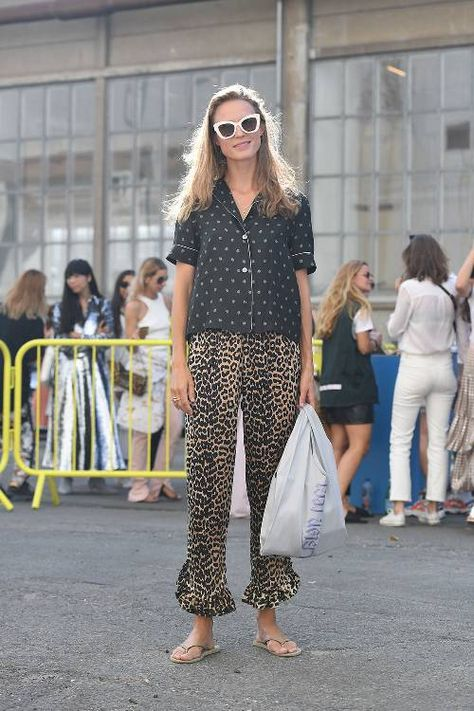 Animal print pants, short-sleeved button down and white-frame sunglasses.