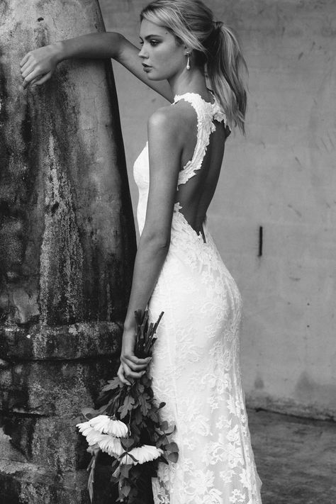 A stunning high neck, figure hugging and unique wedding dress handmade in Australia from luxurious French lace. Worldwide delivery. Order online now!