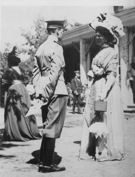 Grand Duke Dmitrii Pavlovich and Empress Alexandra. (Dmitrii was raised primarily by Alexandra's sister Grand Duchess Elizavetta after his Father left Russia to have a morganatic marriage.  Dmitrii was very close to the Empress (and was a possible suitor of her eldest daughter Olga) but later was involved with the plot to murder her confidant Grigorii Rasputin).