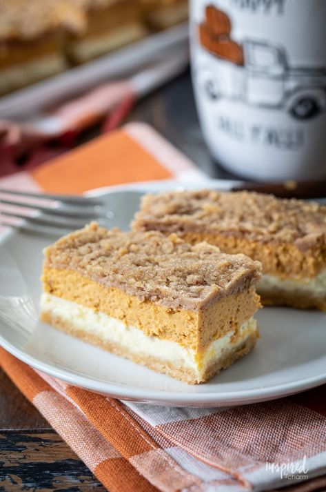 Delicious Pumpkin Cheesecake Bars #pumpkin #cheesecake #bars #pumpkinspice #fallbaking #fall #recipe #dessert