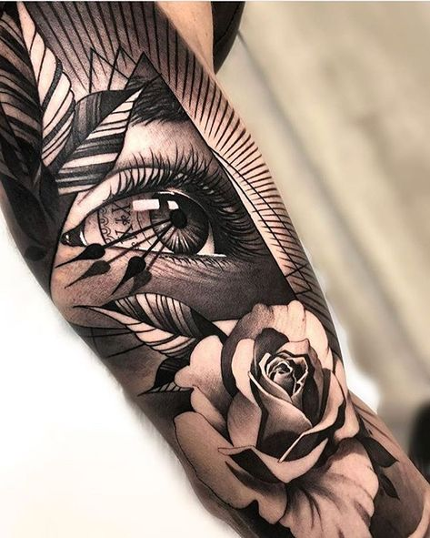 Amazing black and grey realism eye and rose tattoo by @matiasnobletattoo.
